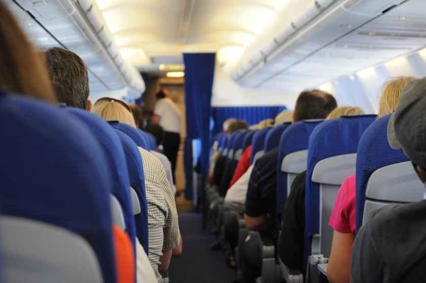 flying-people-sitting-public-transportation.jpg
